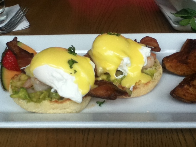 Grilled shrimp eggs benedict with avocado salsa.