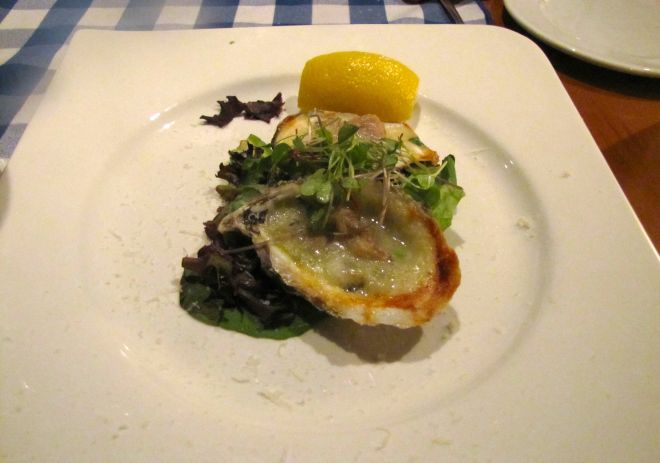 Baked oysters Rockefeller with spinach, butter, shallots, Parmegiano