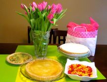 Savoury quiche, dessert pies and fruit salad.